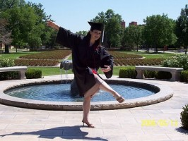 IMAGE A dancer poses in her cap and gown. IMAGE