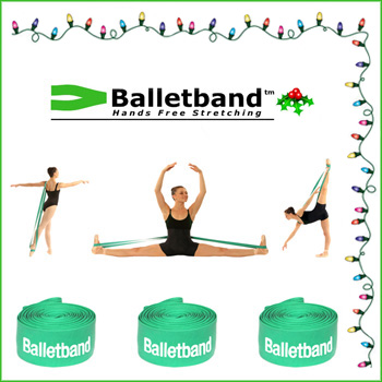 Dancers demonstrate some Balletband exercises surrounded by holiday lights