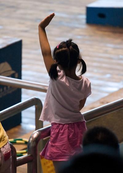 Girl Asking Question - Raising Hand