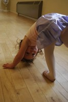 Photo of a little dancer posing upside-down
