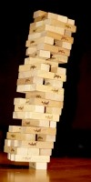 IMAGE A Jenga tower miraculously leans and balances on a single, uncentered, block. IMAGE