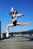 IMAGE Dancer Ashley Whitehead leaping on the docks of Coal Harbour, Vancouver, B.C. on a sunny day. IMAGE