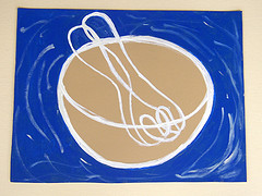 IMAGE A ceramic still-life painting featuring a mixing bowl and spoon. IMAGE