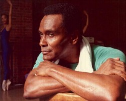 IMAGE Arthur Mitchell rests his chin on folded arms. IMAGE