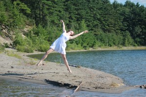 IMAGE A dancer moves with abandon on the rocky shore of a lake. IMAGE