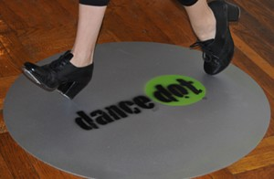 IMAGE Jackie taps on the Dance Dot portable practice floor. IMAGE