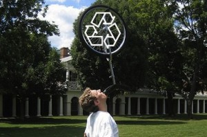 IMAGE Upcycle - a man balances a unicycle on his chin. IMAGE