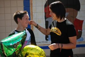 IMAGE A teacher warmly congratulates her student. IMAGE