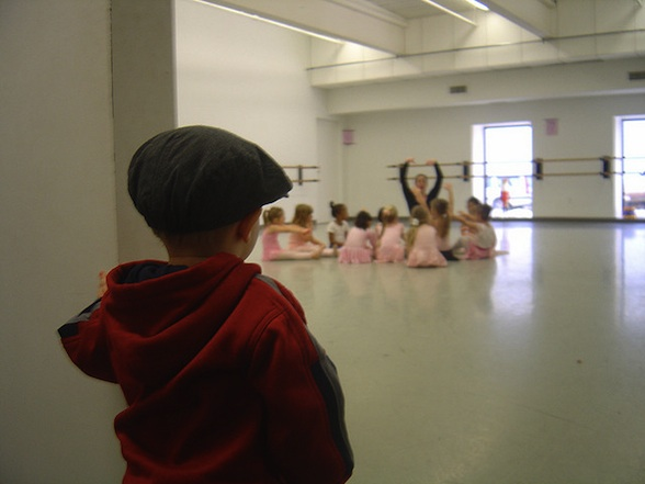IMAGE A little boy watches his sister's dance class IMAGE