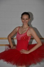 A candid photo of Alexandra in a red tutu.