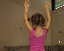 girl dancing, in pink