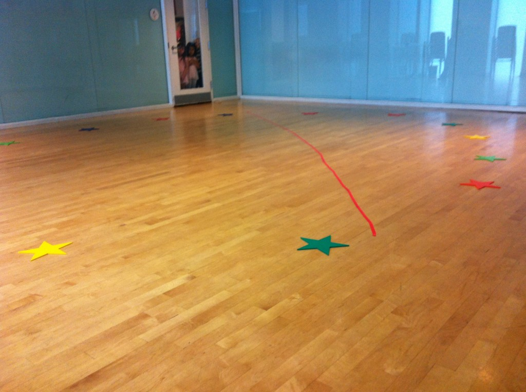 An empty dance studio with little movers waiting at the door