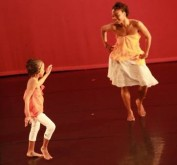 Contributor, Leila Anglin dancing with a young performer
