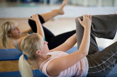 Women practicing pilates