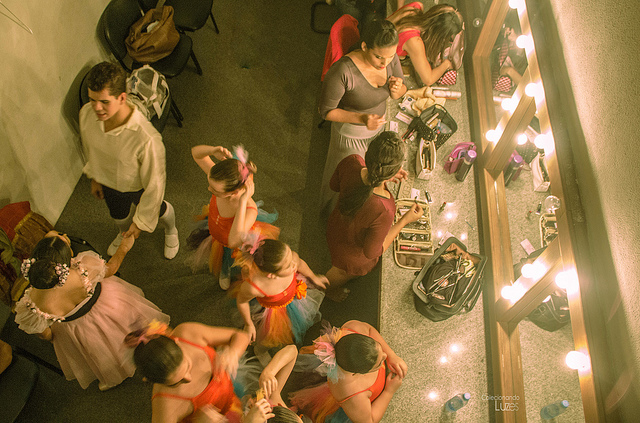 Dancers in dressing room getting ready for ballet performance
