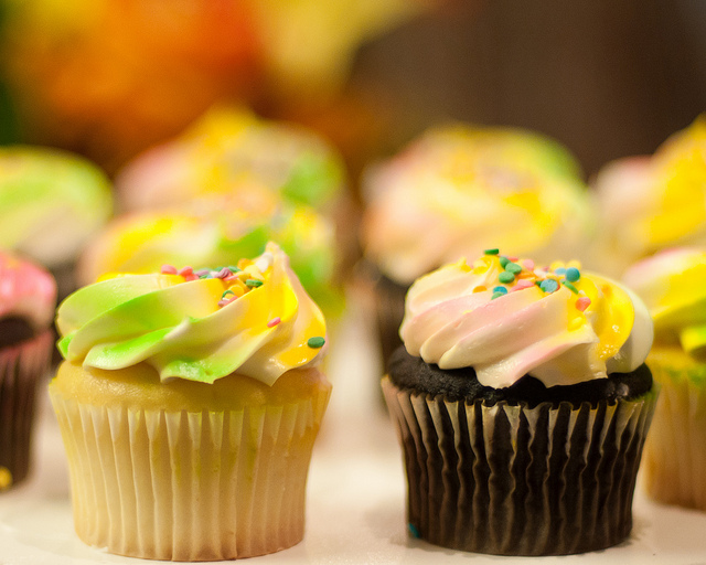 Cupcakes with yellow, green, and white frosting