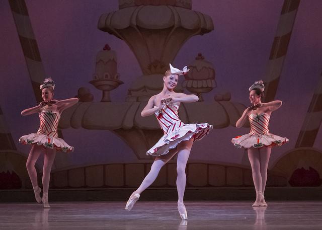 Ballerina in peppermint-striped tutu dancing in Nutcracker