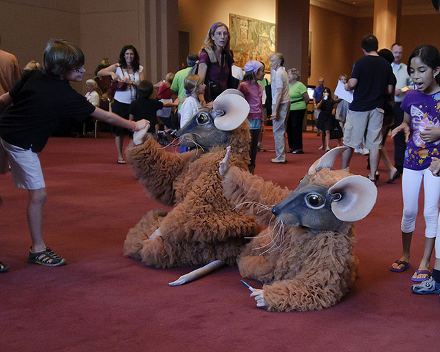Dancers dressed like Nutcracker mice greet peope in theater lobby