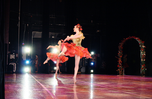 Ballet dancers in floral costumes onstage