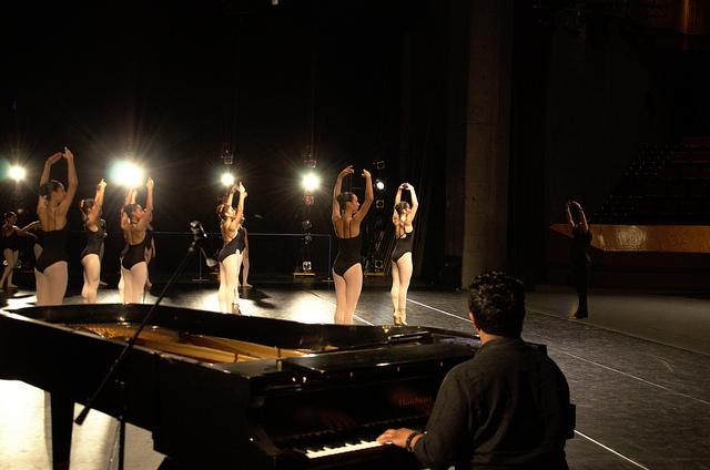 Dancers warming up onstage
