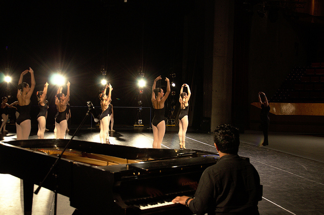 Dancers warming up onstage