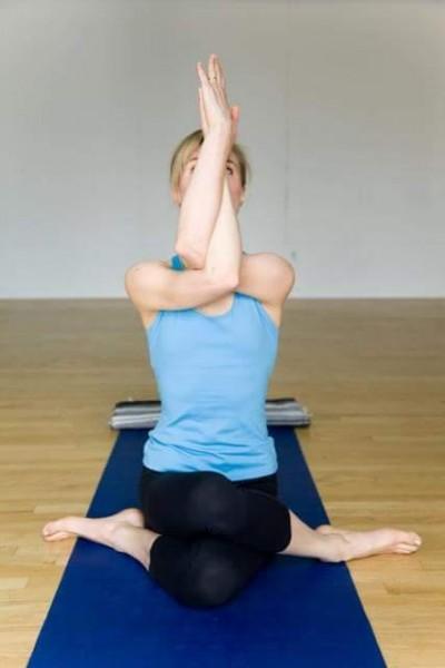 Eagle arms yoga pose