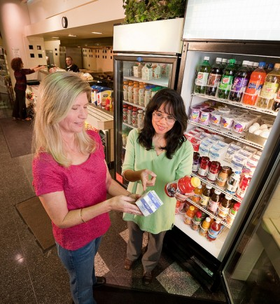 Two women looking at food label