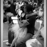 A father and daughter share a hug at dance recital