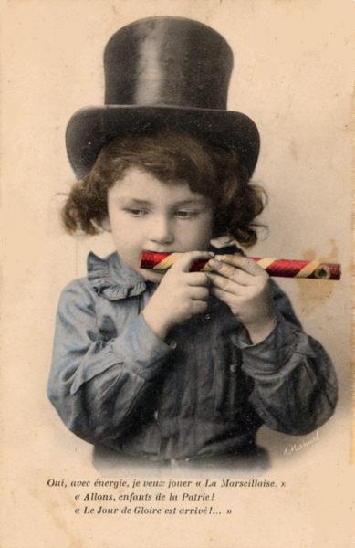 A child playing a mirliton