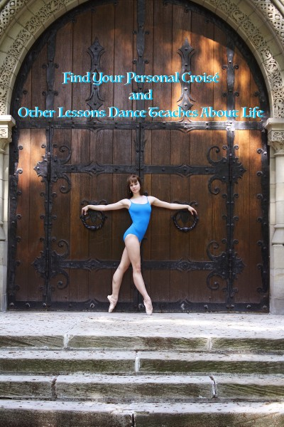 Dancer in blue in front of a large door