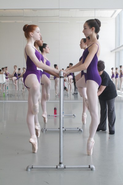 Dancers in purple at barre