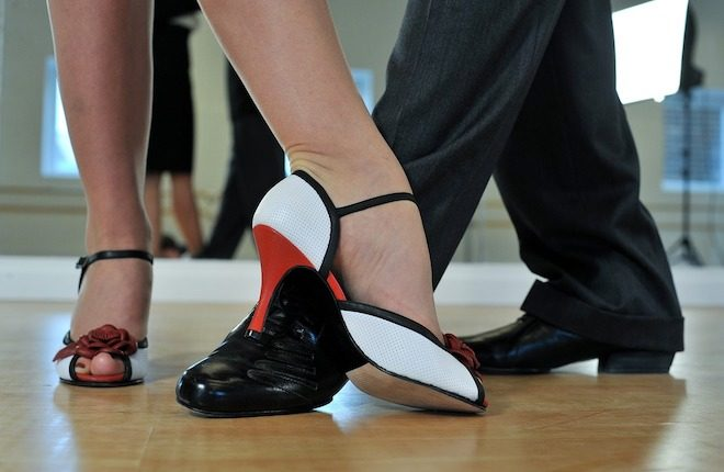 Feet of latin dancers