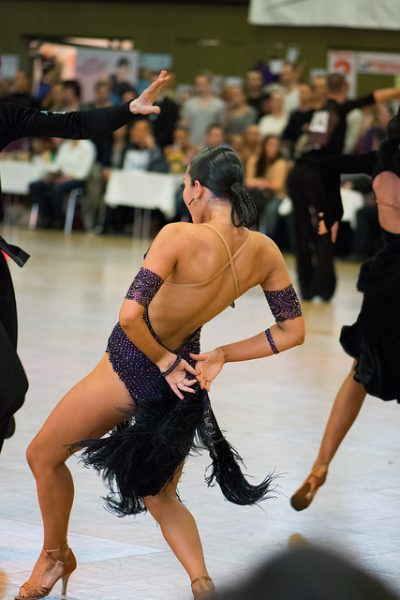 Latin dancer leans back