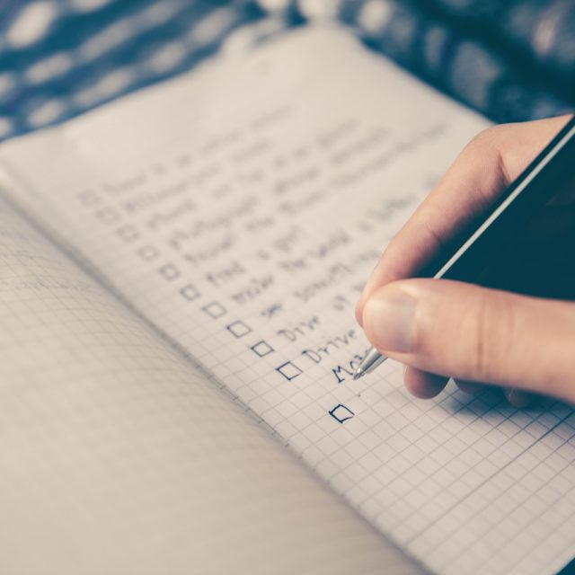 A notebook with a checklist