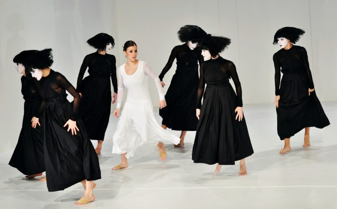 Dramatic dance piece with painted faces and girl in white