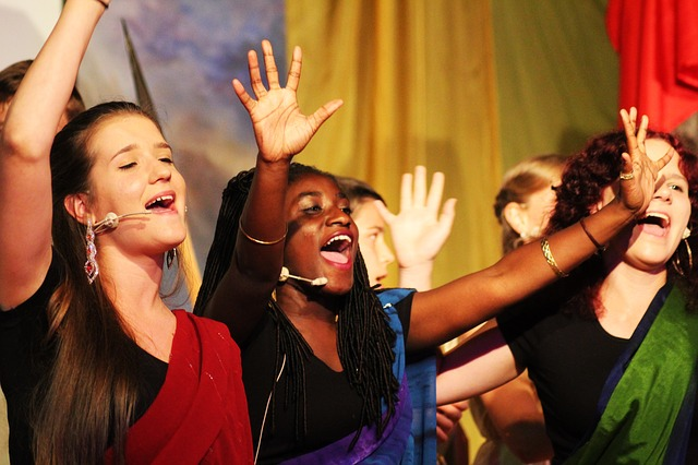 Young women singing in a musical