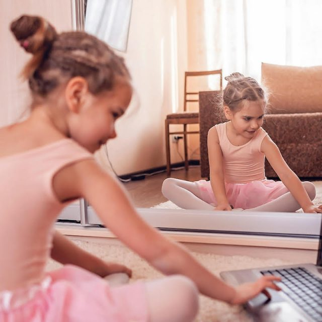 Young dancer sitting at a computer
