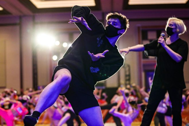 Kieran Macdonald assisting Stacey Tookey at NUVO Dance Convention. Photo by Kate Watt.